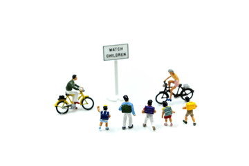 Miniature people : student or children crossing road on way to school,Back to school concept.