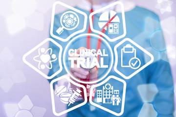 Woman medic touches a clinical trial words surrounded by specific icons. Clinical Trial Medicine Pharmaceuticals concept. Science Hospital Research.