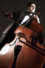 Poster Muziek Double bass player contrabass playing. Classical musician