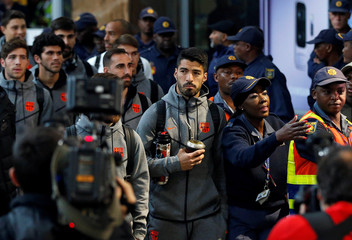 Barcelona's Luis Suarez arrives with teammates for the Nelson Mandela Centenary Challenge against South Africa's Mamelodi Sundowns at the FNB Stadium, in Johannesburg