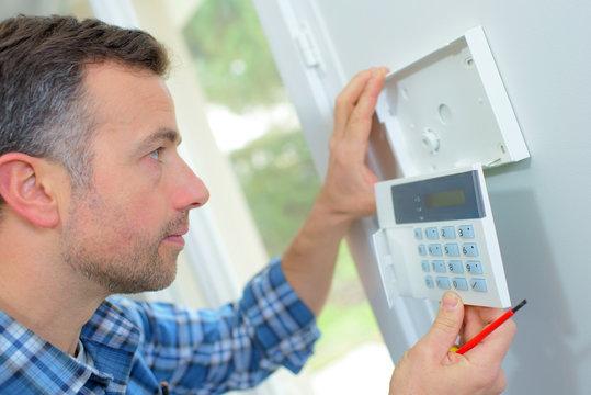 skilled entrepreneur installing new intercom system