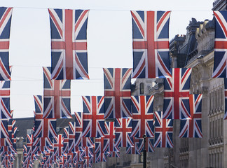 Union Jack flags hang in Central London in preperation for the royal wedding