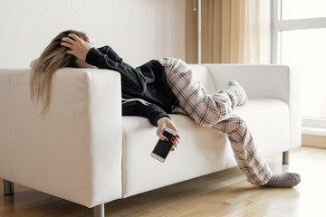 Apathic lazy woman lying in sofa