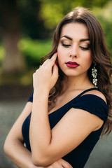 Portrait of beautiful girl with prifessional makeup and hair style