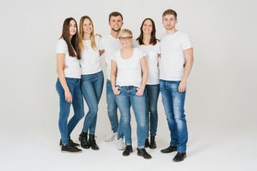 Group of trendy friends in jeans and t-shirts
