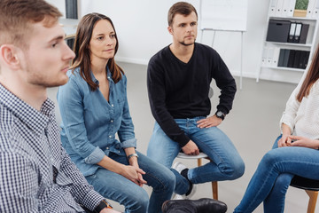 Group of people attending a meeting