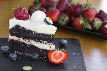 Delicious Chocolate Cake made with white and dark chocolate, fruits and coconut