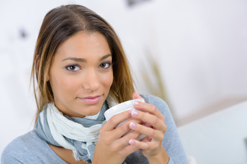 woman holding a cup of beverage