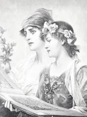 Dwie młode piękności trzymają książkę - 205196110