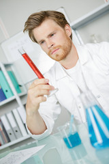 Scientist holding a graduated cylinder