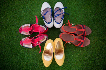 .Rockabilly hen-party in park. Girls shoes on the grass