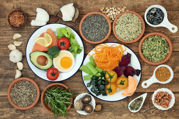 Brain boosting healthy super food concept with fish, dairy, vegetables, seeds, pollen grain, nuts and herbs. Foods high in omega 3, vitamins, minerals, antioxidants and anthocyanins.