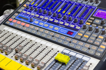 Closeup Mixing Console of a big HiFi system  The audio equipment, a control panel of digital studio mixer.