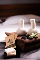 Towels set in hotel bedroom