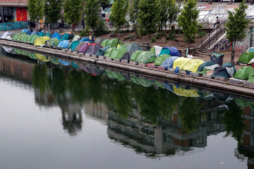 Tents where migrants live are seen on the Quai de Valmy of the canal Saint-Martin in Paris