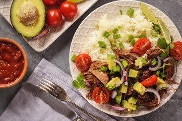 Pulled lamb with boiled rice and vegetables.