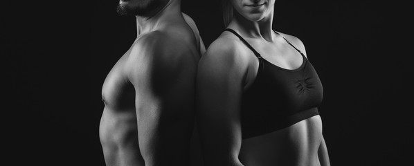 Fitness workout couple with perfect upper bodies