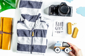 accessories for treveling with children, camera and suit on whit