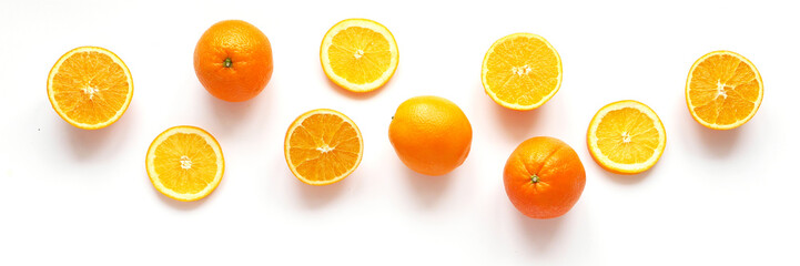 Fototapete - Creative flat layout of fruit, top view. Sliced orange isolated on white background.