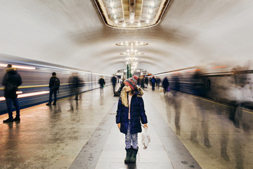 One life as one trip on the subway. All passengers - the people in your life. Who will ride with you to the last stop? Motion blur subway and people waiting at subway station. Wall mural