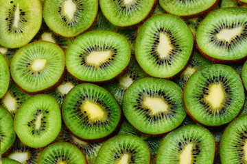 top view of heap of sliced kiwi as textured background