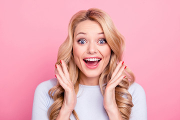 Wall Mural - Sale! Portrait of glad full of happiness girl with wide open mouth eyes holding palms near cheek gesturing with hands looking at camera isolated on pink background