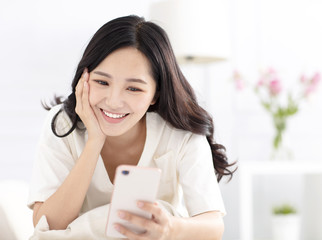 happy young woman  watching the smart phone