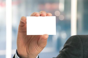 Businessman showing an empty business card