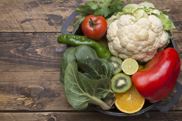 Various fruits and vegetables with vitamin c in cooking pot