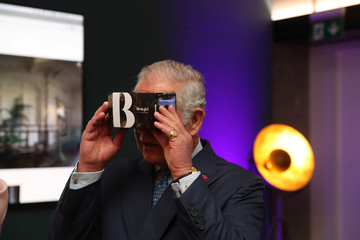 Britain's Prince Charles looks through a virtual viewer during a visit to the YouTube Space in Kings Cross, London