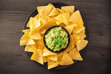 mexican guacamole dip and nachos tortilla chips