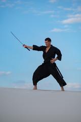 Garden Poster Martial arts Man is training martial arts in desert
