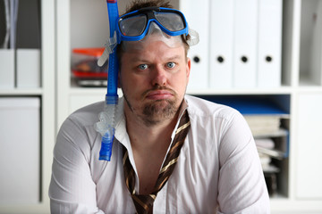 Man wearing suit and tie in goggles with snorkel