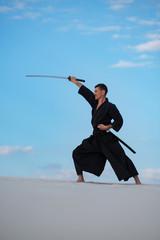 Garden Poster Martial arts Man is training Japanese martial arts in desert
