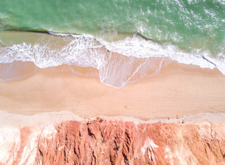 Wall Mural - Drone shot of tropical sandy beach and ocean with clear turquoise water.