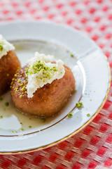 Turkish Traditional Dessert Kemalpasha, Shekerpare with Cream on Top