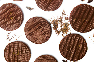 Round chocolate biscuits on white background