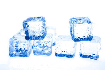 Blue ice cubes on white background.