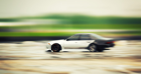 Sport car wheel drifting. Blurred of image diffusion race drift car with lots of smoke from burning tires on speed track. Sport concept,Drifting car concep