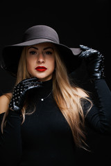 Photo of young blonde in hat , gloves