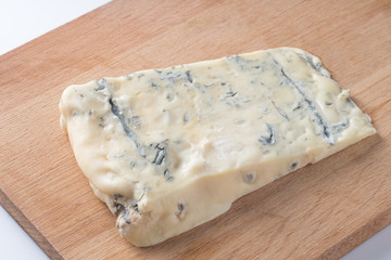 Blue cheese on a wooden serving board