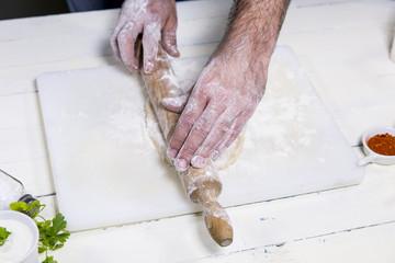 hands working bread dough