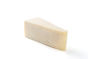 Semi hard cheese piece on a white background