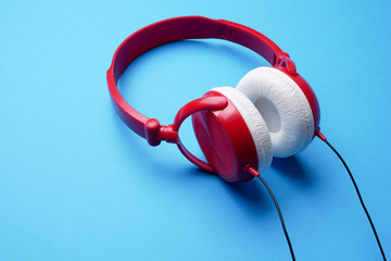 Image of red with white headphones for music close-up