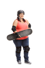 Overweight woman wearing protective gear holding a skateboard
