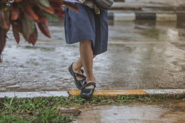 Students walk to the flood after rain in school.