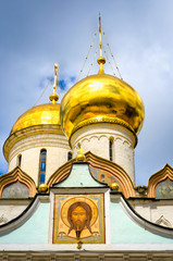 Segiyev Posad, Russia - August 30, 2012: View of Trinity Cathedral domes and exterior wall painting at Holy Trinity St. Sergius Lavra.