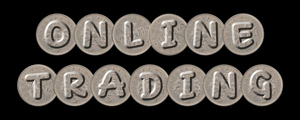 ONLINE TRADING  written with old British coins on black background