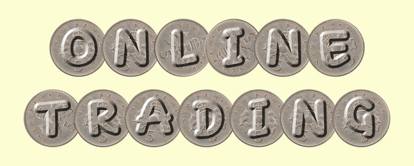 ONLINE TRADING  written with old British coins on yellow background