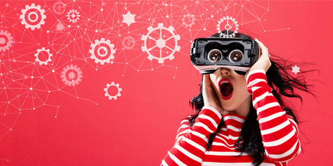 Gears with young woman using a virtual reality headset